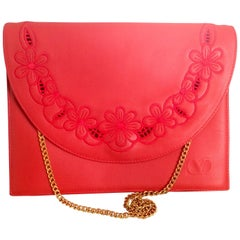 Vintage Valentino Garavani red clutch shoulder bag with flower embroidery deco.