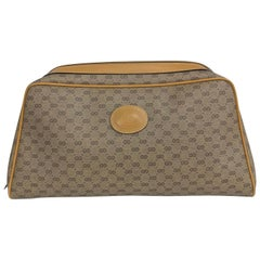 Vintage Gucci logo coated canvas and leather clutch 1980s