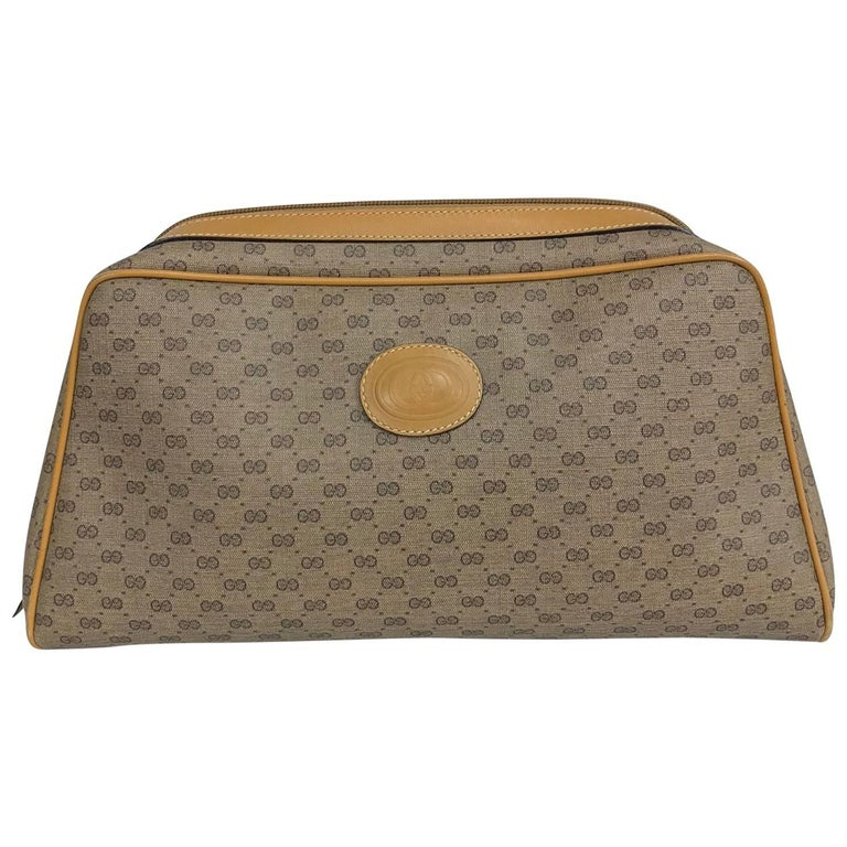 Vintage Gucci logo coated canvas and leather clutch 1980s For Sale