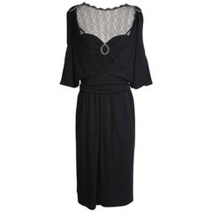 Chanel Black Dress with Mesh Neckline and Ring Medallion
