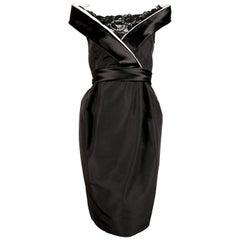 Alexander McQueen black satin dress with raised collar, 2006