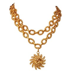 Chanel short gilded metal necklace with sun-shaped pendant, 1994 Fall Collection