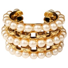 1990s Chanel cuff bracelet composed of pearly beads and gilt chain