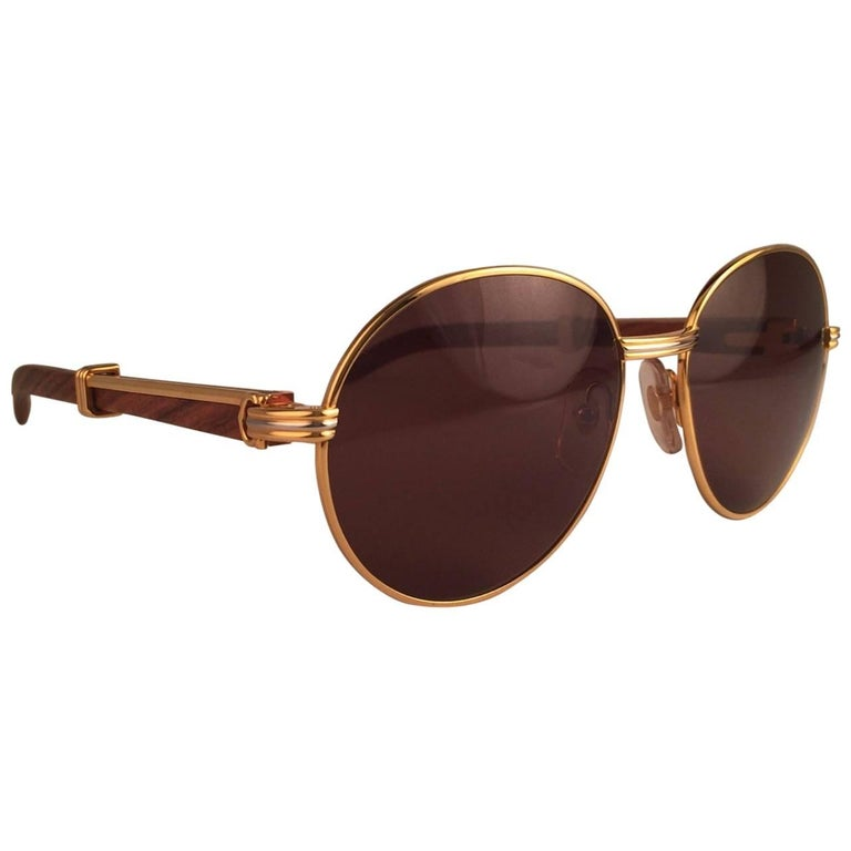 54e1563aa4 New Cartier Wood Bagatelle Round Gold and Precious Palisander 55mm Brown  Lens at 1stdibs