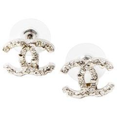 CHANEL CC Stud Earrings in Silver Metal and Rhinestones