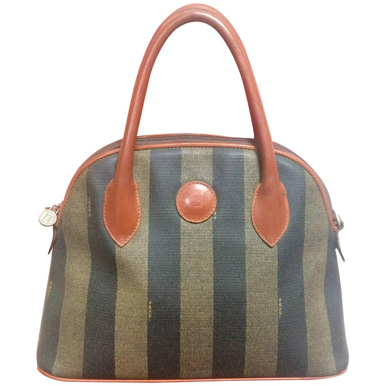 Vintage FENDI black and grey pecan stripe bolide shape bag with brown handles.