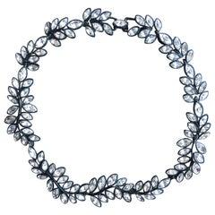 KJL black metal and crystal leaf necklace