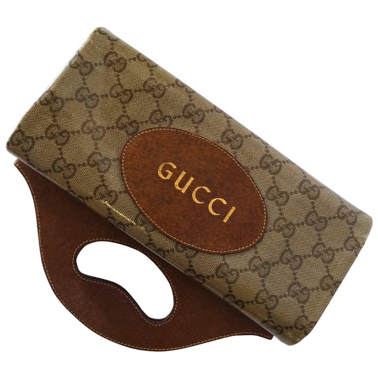 1970s Gucci Monogram Canvas Vinyl Fold-over Hand Bag For Sale