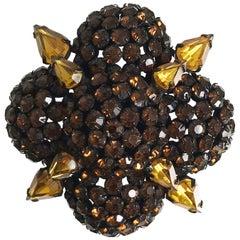 Warner large quatrefoil amber rhinestone encrusted pin