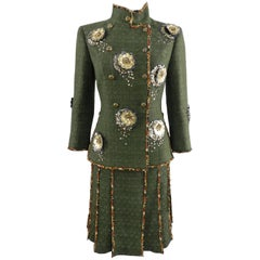 Chanel Pre-Fall 2010 Shanghai Runway Green skirt Suit with Gold Lesage Camelias