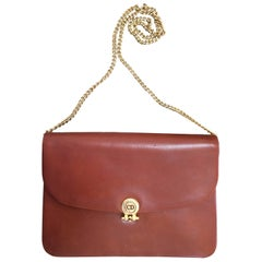 Vintage Christian Dior Vintage brown clutch bag with CD motif and golden chains.