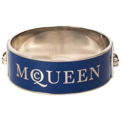 Alexander McQueen Cuff in Navy Blue With Raised Silver Lettering