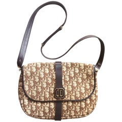 Vintage Christian Dior brown trotter jacquard and leather shoulder bag with CD.