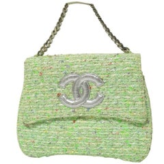 Vintage CHANEL light green tweed fabric handbag with silver tone chain strap.