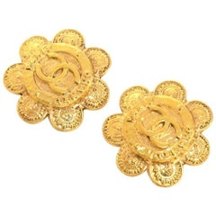 Chanel Gold Tone Flower Motif Earrings