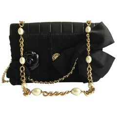 Chanel Black Leather And Tweed Flap Bag With Removable Camellias And Bow