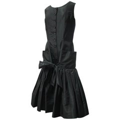 1950s Traina-Norrell Black Taffeta Cocktail Dress Hip Pockets and Flared Hem