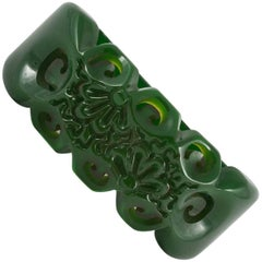 Carved green bakelite clamper bracelet, 1930s