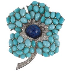A large turquoise and lapis cabuchon  'flower' brooch, Marcel Boucher, 1960s