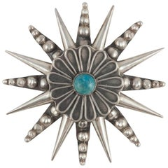 Mexican Sterling silver and turquoise 'star' pendant or brooch, 1950s