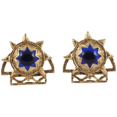 Blue glass cabochon and rusticated gilt earrings, Claire Deve, 1980s