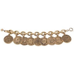 Early 'Cheap and Chic' antiqued gilt coins charm bracelet, Moschino, 1990s