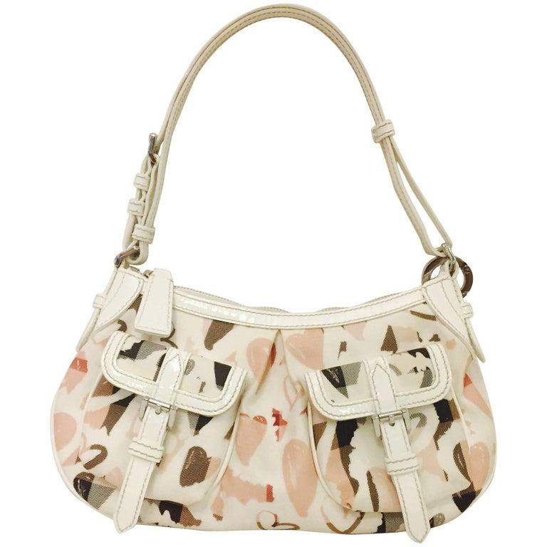 Brilliant Burberry Hobo Style Ivory & Nova Heart Pattern Top Handle Bag
