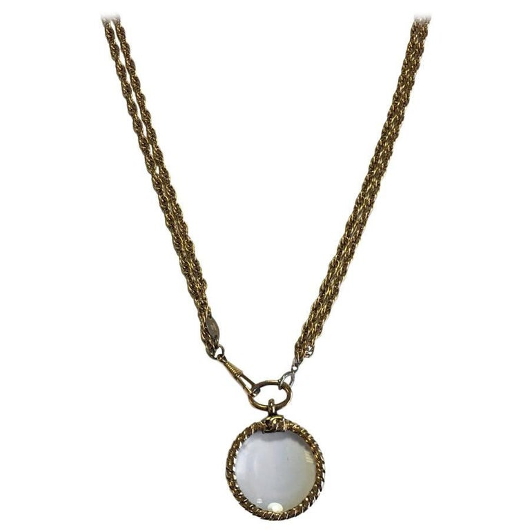 CHANEL Double Chain Necklace in Gilded Metal with a Magnifying Glass  For Sale