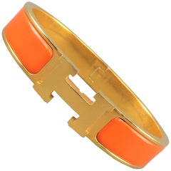 HERMES 18k Gold Plated Orange Enamel Clic H Bangle Bracelet