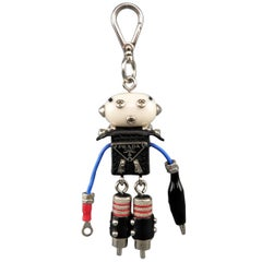 PRADA Black Red & Blue Mixed Materials Enamel Plaque Sid Robot Key Chain $285.00
