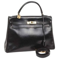 HERMES Vintage Kelly 32 Bag in Black Box Leather with its Strap