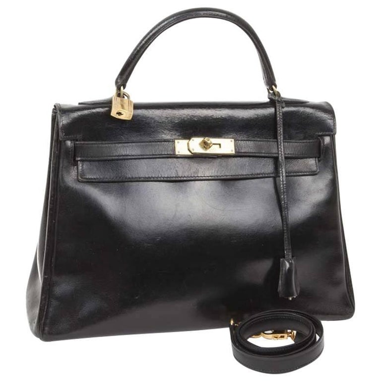 HERMES Vintage Kelly 32 Bag in Black Box Leather with its Strap For Sale