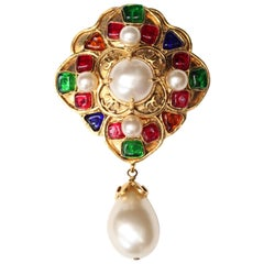 1994 Chanel gilded metal cross brooch with glass paste cabochons
