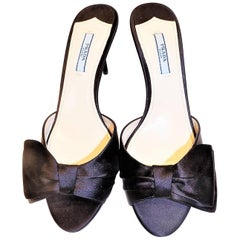 Prada black silk evening mules with asymmetric bow