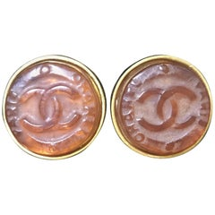 Vintage CHANEL brown candy earrings with  gold tone frame and engraved logo.