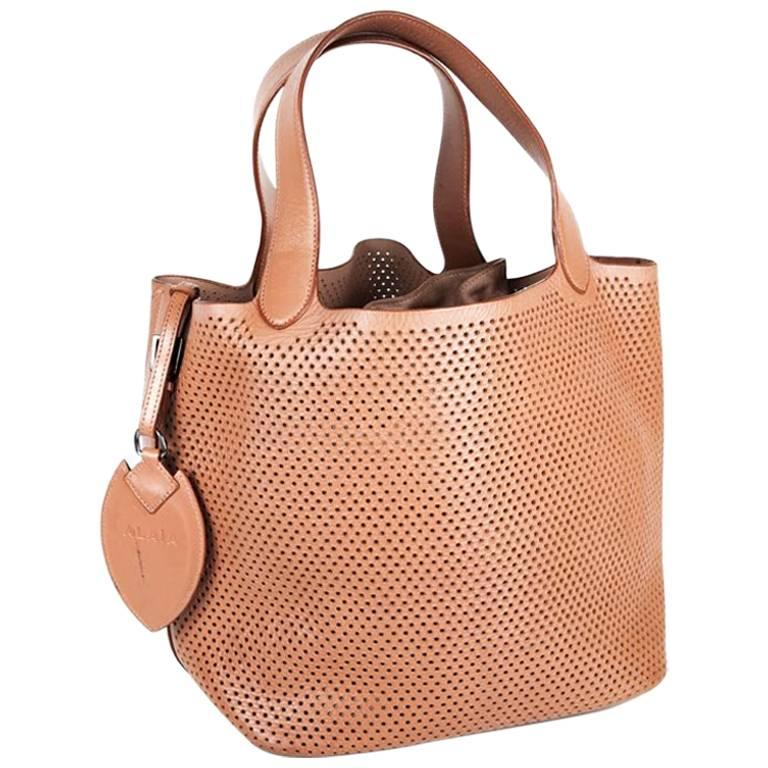 Alaia Perforated Bag In Smooth Gold