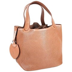 ALAIA Perforated Bag in Smooth Gold Leather