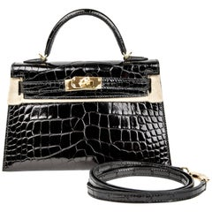 Hermes Kelly 20 Noir (Black) in Croco Leather Gold Hardware (GHW) Stamp A (2017)