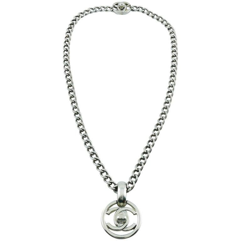 Chanel Vintage 1997 Silver Toned Turn Lock Pendant