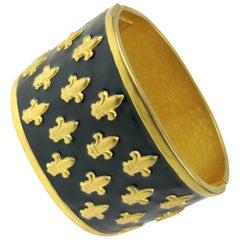 Karl Lagerfeld Enamel-Gold Tone fleur de lis Massive Never worn bracelet 1990s