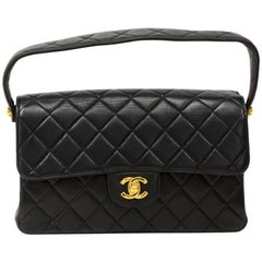 Chanel 10 inch Double Sided Black Quilted Leather Flap Handbag