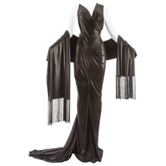 John Galliano backless black evening gown with fringed shawl