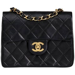 1989 Chanel Black Quilted Lambskin Vintage Mini Flap Bag