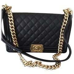 Chanel Medium Boy Bag in Quilted Caviar Leather.