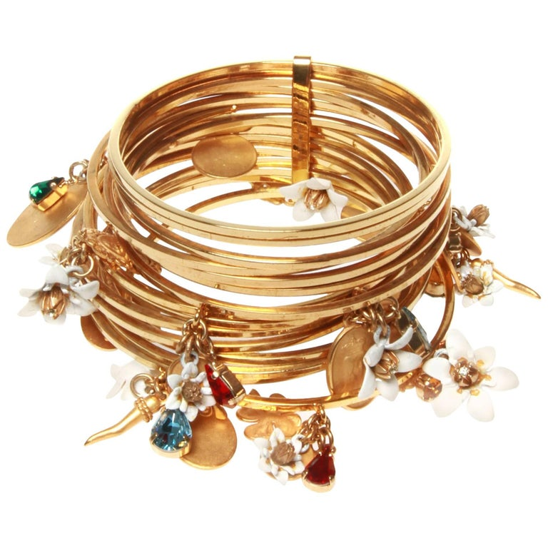 37c1a21ffd3 Dolce and Gabbana Gold Stacked Charm Cuff Bracelet For Sale at 1stdibs