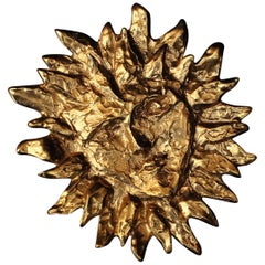 Yves Saint Laurent gilded metal sun-shaped brooch, 1980s