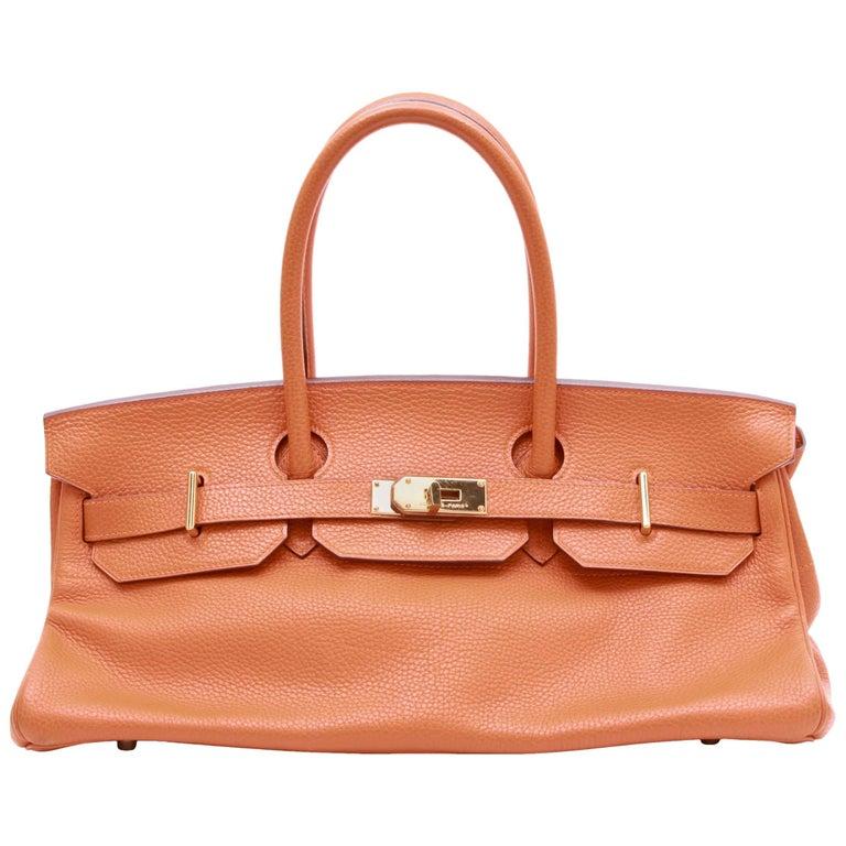 HERMES 'Shoulder' Bag in Orange Taurillon Clémence Leather