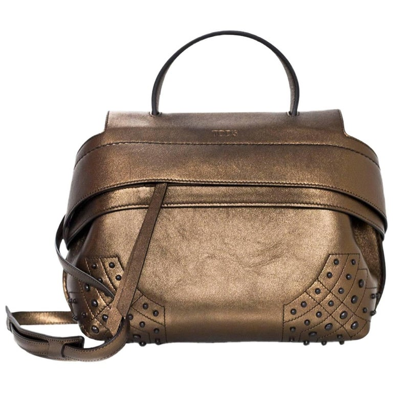 Tod's Bronze Small Wave Gommini Top Handle Bag with Strap rt. $2,165 For Sale
