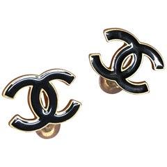 Chanel black enamel and matte gold CC logo clip earrings