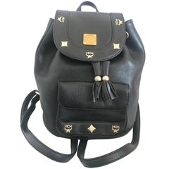 Vintage MCM black backpack with golden studded motifs, by Michael Cromer